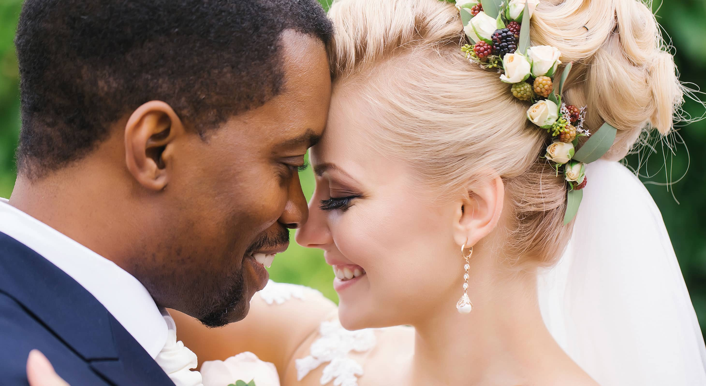 Bride and groom lovingly touch foreheads on their wedding day at our Bar Harbor wedding venue