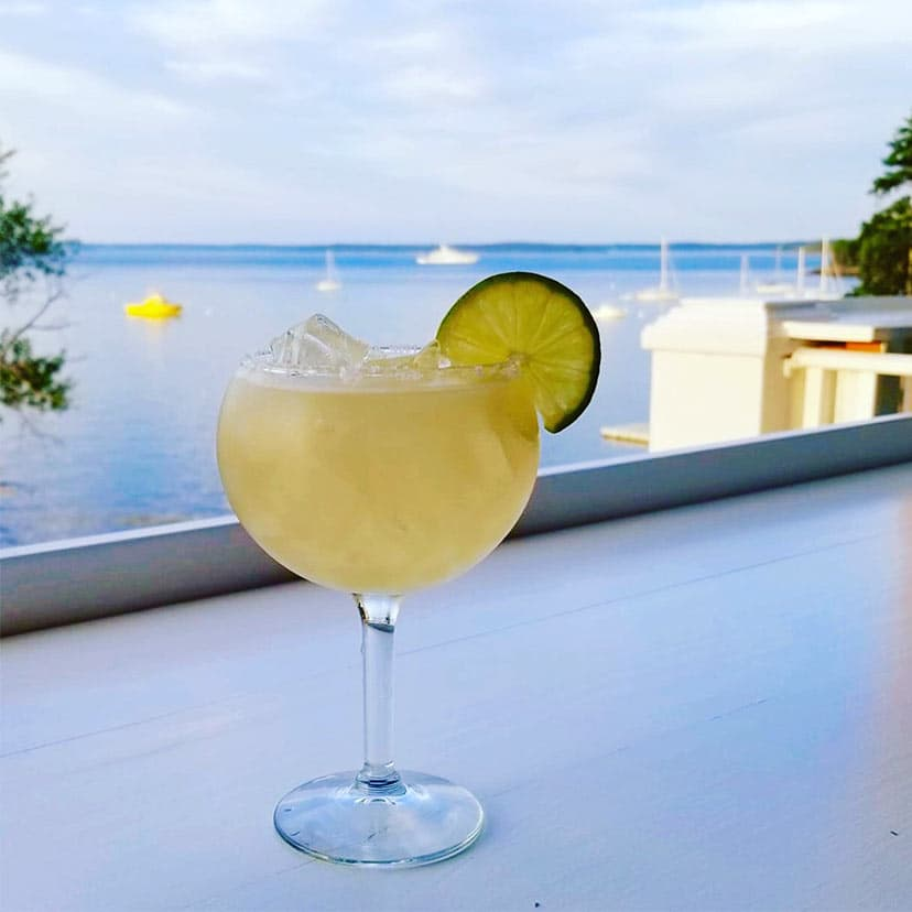 Cocktail on the deck with ocean views at our hotel in Bar Harbor