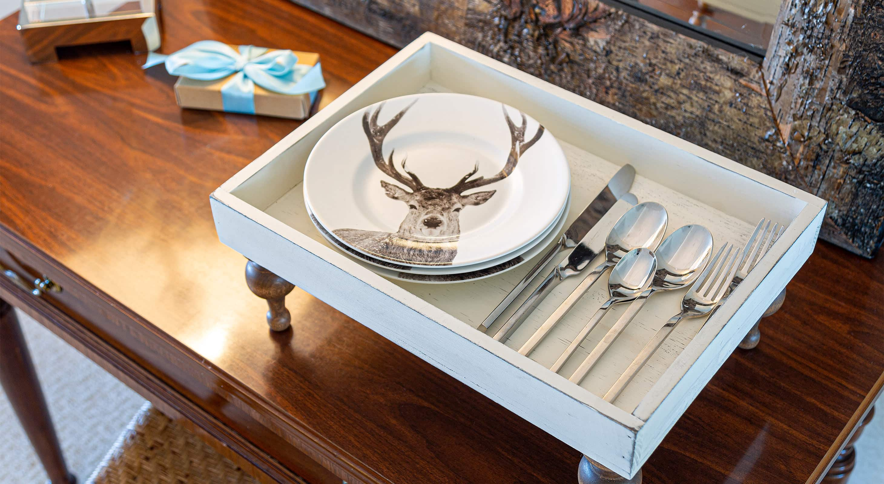 Dinner plates featuring a deer graphic with utensils