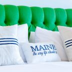 King bed with green headboard and text