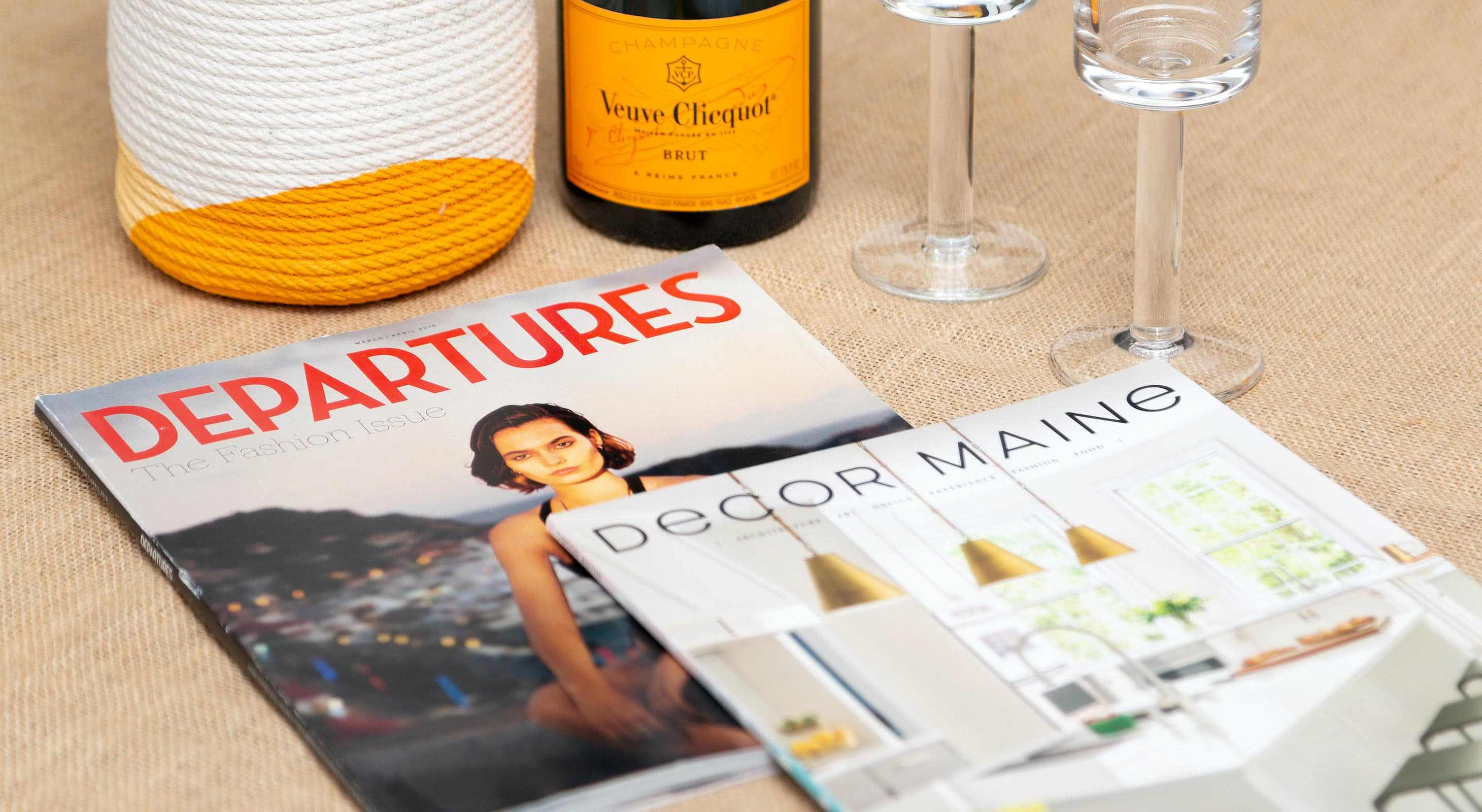 Table set with Magazines including Decor Maine and Departures