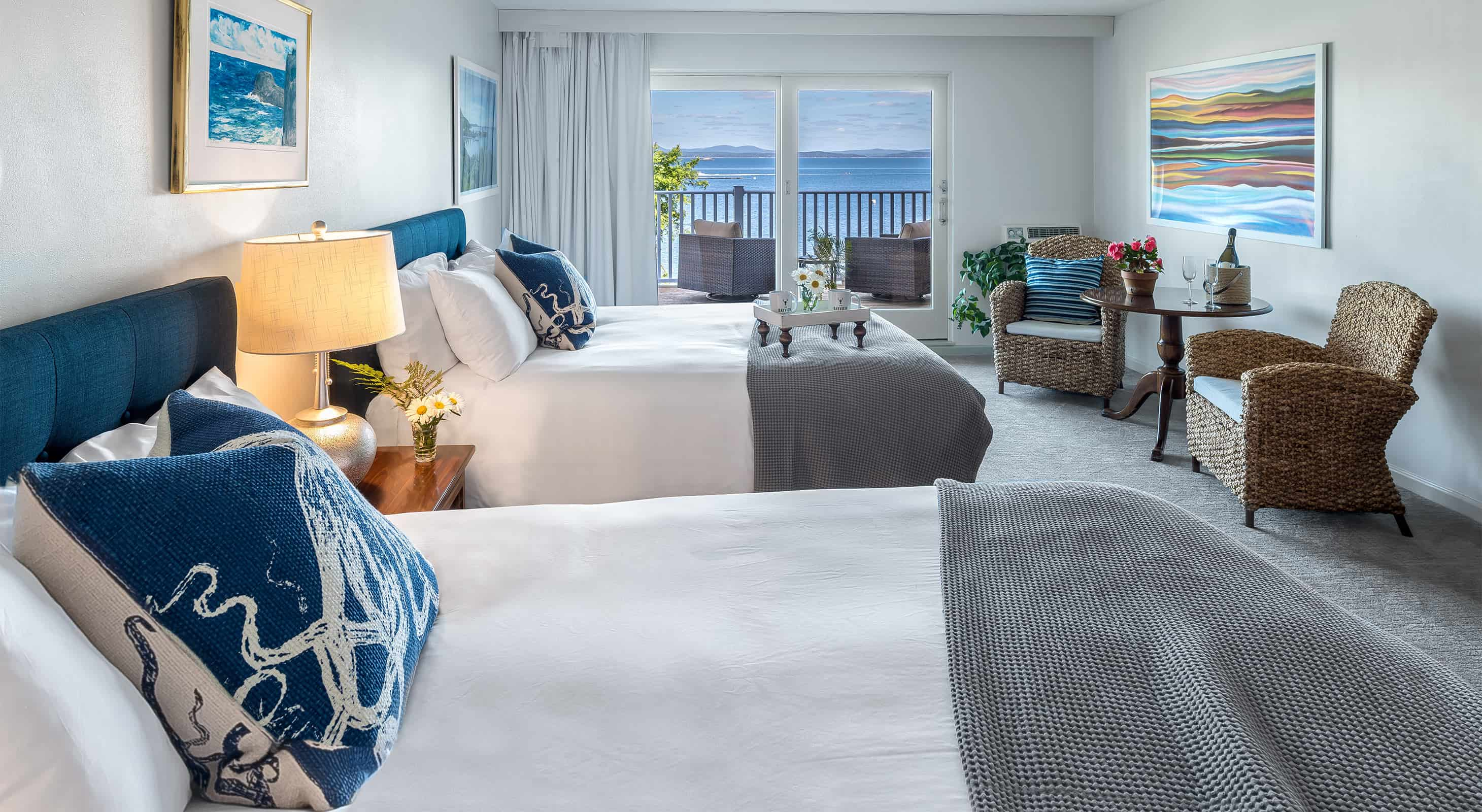 Two Queen Beds with ocean view and seating area