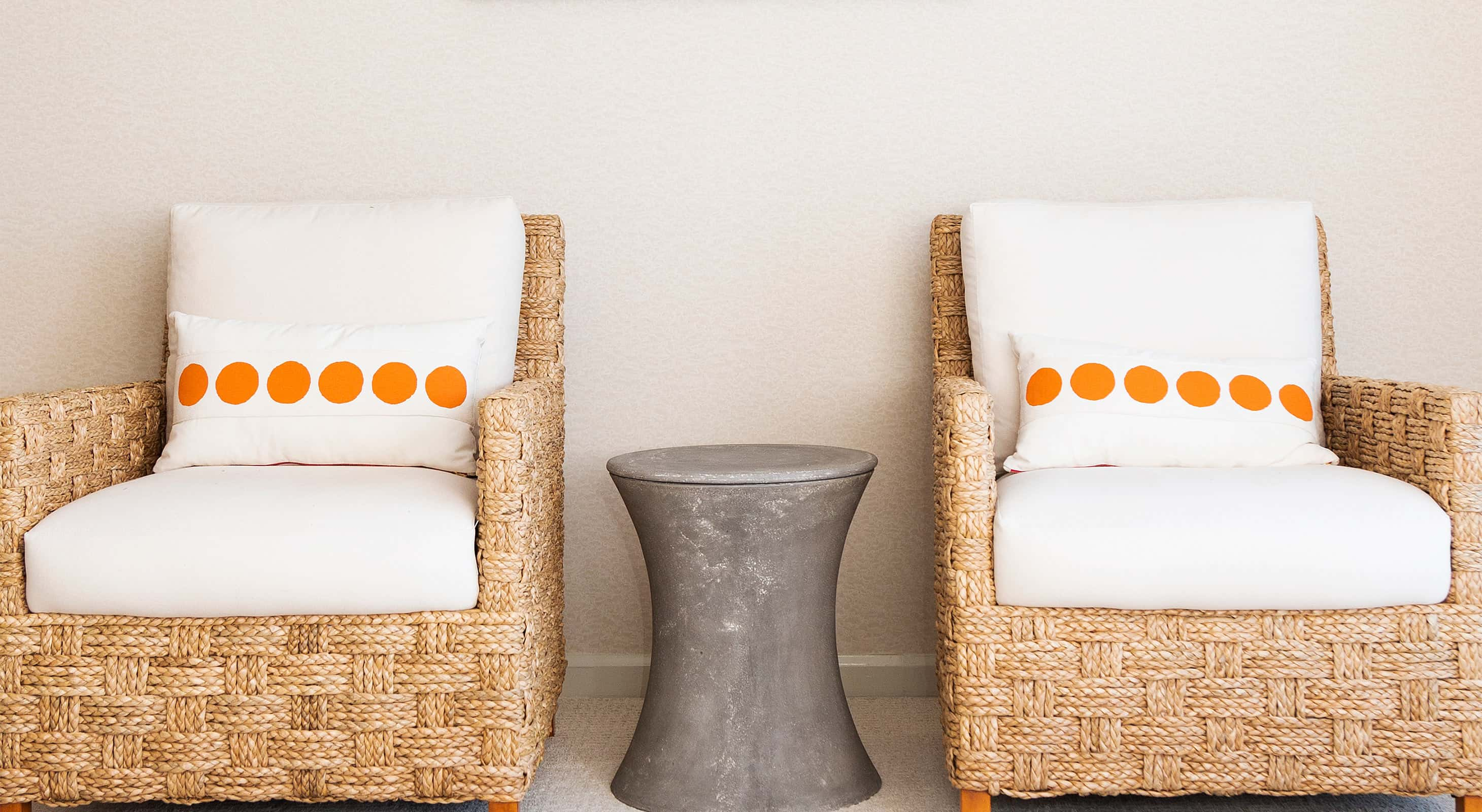 Two Palecek chairs in the Peak Room at our Bar Harbor boutique hotel
