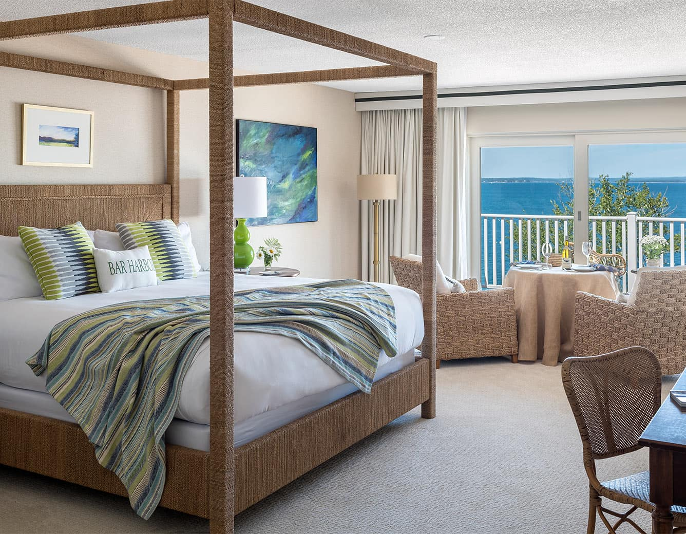 King Bed and chairs and oceanfront view