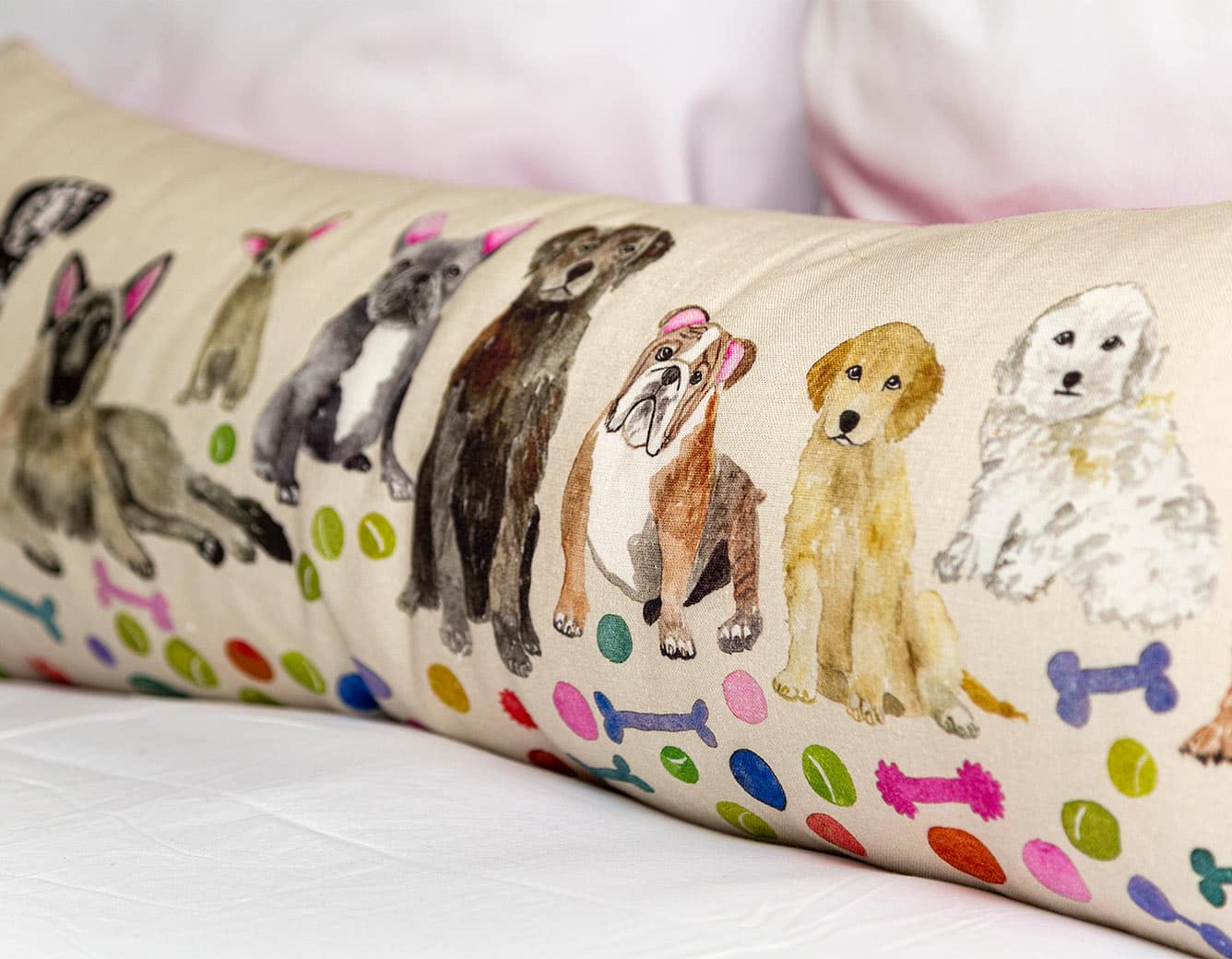 Pillow with lots of breeds of dogs
