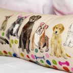 Pillow with lots of breeds of dogs on it at our Bar Harbor pet friendly hotel