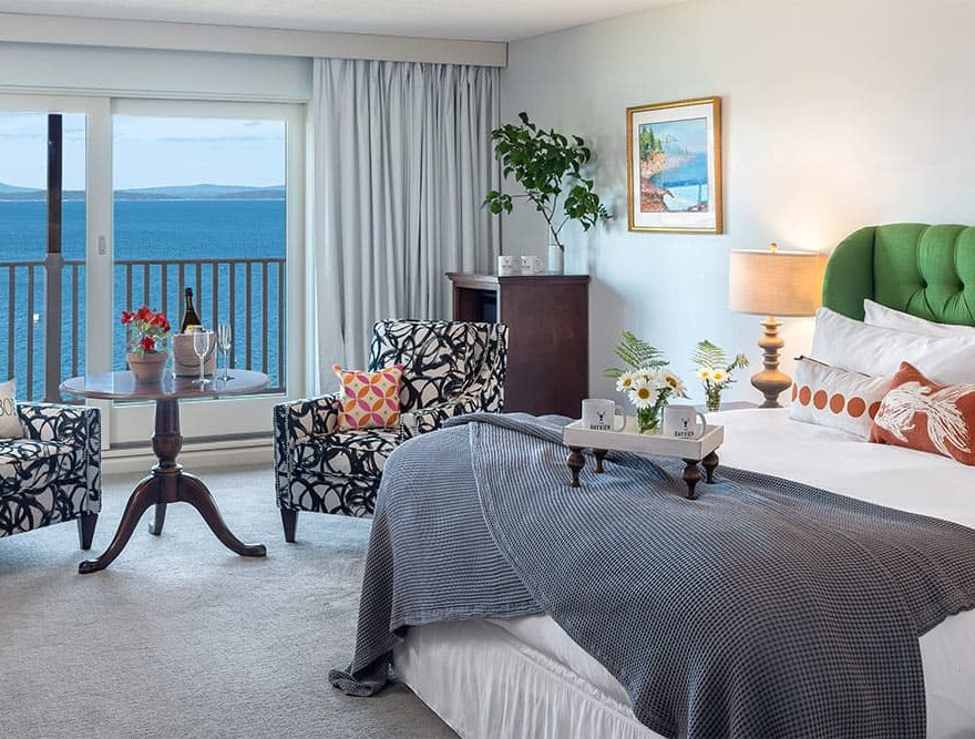 Ocean King Bed and sitting area with oceanfront view