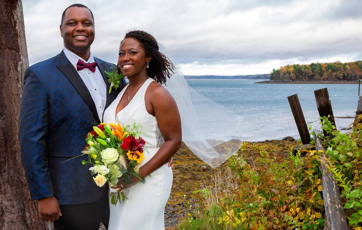 newlywed couple by the water at their Elopement in Maine