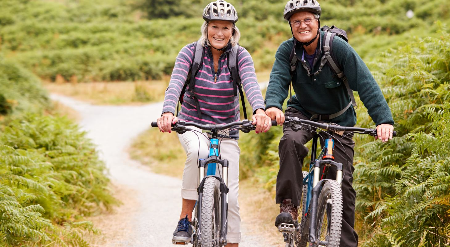 Couple biking on path on romantic getaway from NY