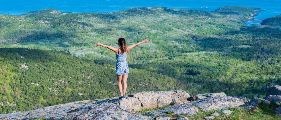 Girl on hike overlook during getaway from New York